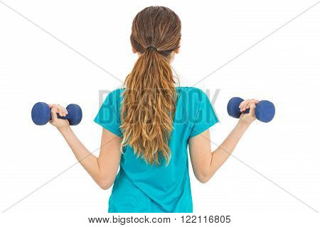 Woman holding weights rearview. Isolated on white background.