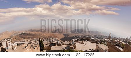 Mardin city of Turkey with Mesopotamia background.