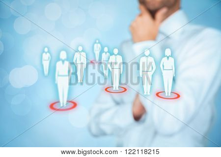 Target audience (marketing) concept. Businessman think about target audience and customers represented by icon.