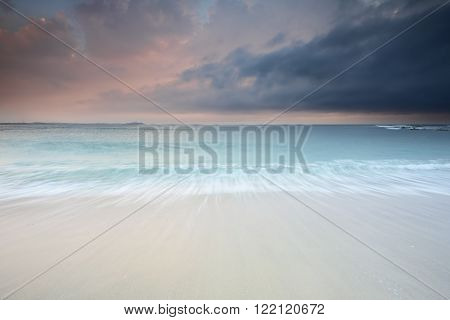Formidable skies and approaching storm over sea at sunrise