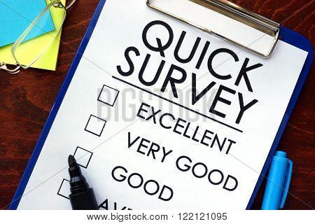Quick Survey written in a notebook. Marketing concept.