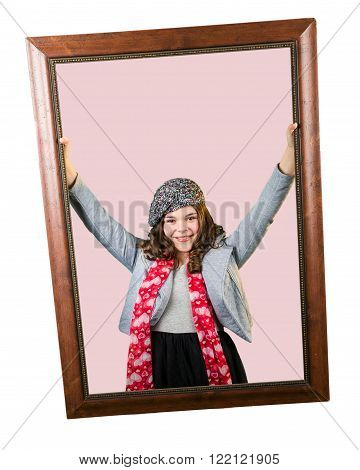 Cute fun and stylish caucasian tween girl holding picture frame isolated on white