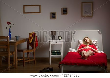 Photo of depressed lonely girl resting in her room