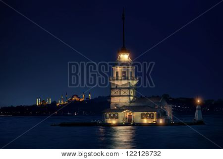 Maiden's Tower in Istanbul at night with Hagia Sophia and The Blue Mosque on the background