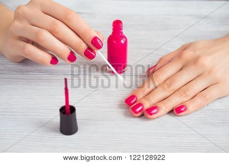 Female Hands With Red Manicure Holding Cotton Wool On A Stick
