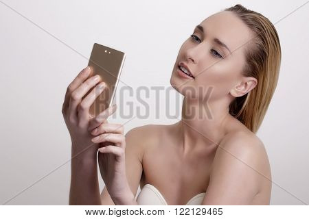 Beautiful Woman Take A Smiling Selfie With Smartphone