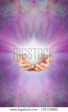 Receiving a Reiki Attunement - female cupped hands with burst of white energy above on a beautiful intricate feminine purple pink energy formation background with plenty of copy space