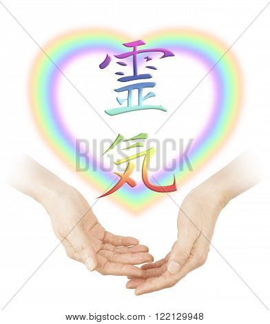 Sharing Reiki healing - Female cupped hands with a soft focus heart shaped rainbow and a rainbow colored Japanese Reiki Symbol floating above on a white background