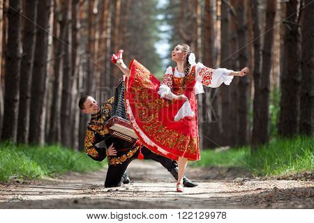 Couple of dancers in russian traditional costumes ** Note: Visible grain at 100%, best at smaller sizes
