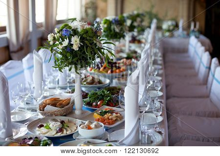 Served for a banquet table. Wine glasses with napkins glasses and salads.