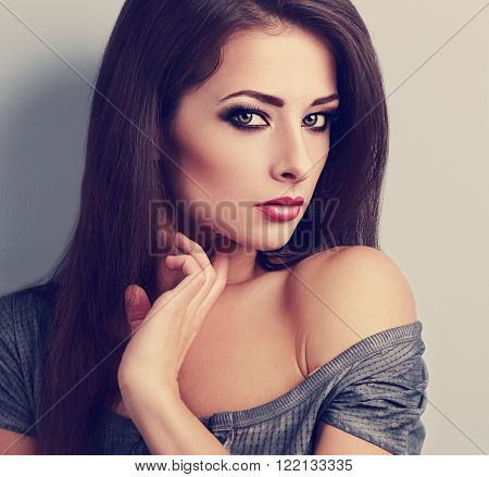 Beautiful Brunette Female Model With Expressive Smoky Eyes Make-up Looking. Closeup Toned Portrait