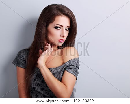 Beautiful Bright Makeup Woman With Long Smooth Hair Style Looking Sexy On Blue Background