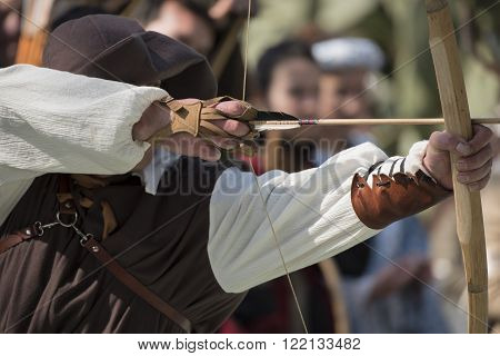 A medieval archer with the starting arrow