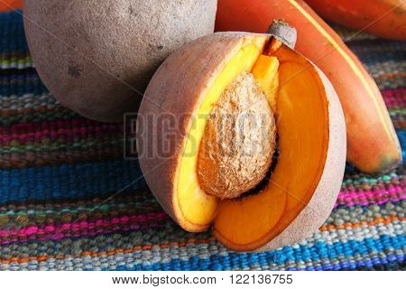 Close-up of sliced mamey sapote fruit on a colorful place mat