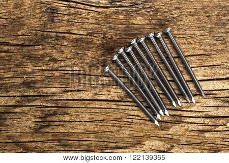 close up view of nails on wooden plank