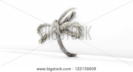 Handmade natural cord bow tied on white letter package, isolated