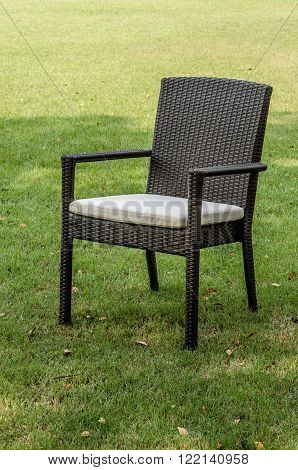 Water resistant rattan chair with cushion in the garden