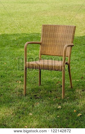 Brown water resistant rattan chair in the garden