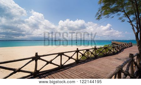 In the picture the beautiful wooden bridge leading to the beach on the island of slaves Zanzibar Republic of Tanzania