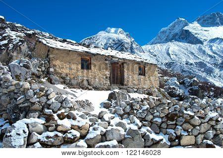 Abandoned stone cabin in the mountain, along the trail to Mount Everest Base Camp, Nepal Himalaya