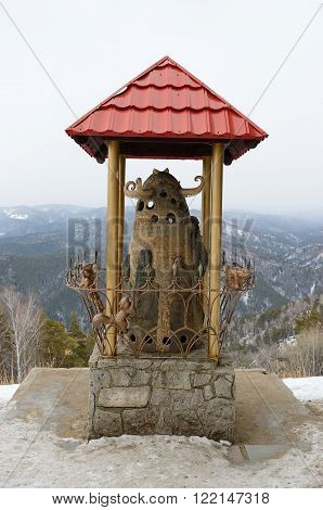 Sculpture on the top of Tserkovka mountain in the vicinity of the resort Belokurikha, Altay, Russia.