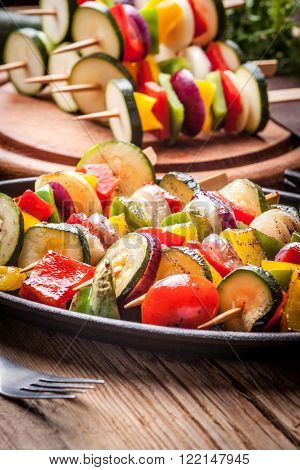 Vegetable skewers on a cast iron skillet.