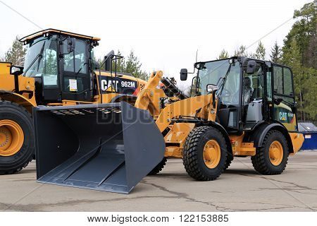 LIETO, FINLAND - MARCH 12, 2016: Cat 906M Compact wheel loader and other Cat construction equipment as seen at the public event of Konekaupan Villi Lansi Machinery Sales.
