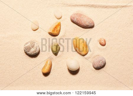 Collection Of Eleven Sea Stones On Sand