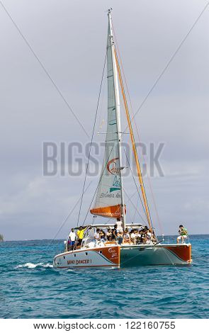 MAURITIUS - APRIL 24: tourists float on a catamaran in the Indian Ocean on April 24 2012 in Mauritius