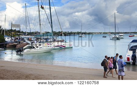 MAURITIUS - APRIL 24: tourists go on catamarans to the Gabrielle's island. Grand Bay (Grand Baie) on April 24 2012 in Mauritius