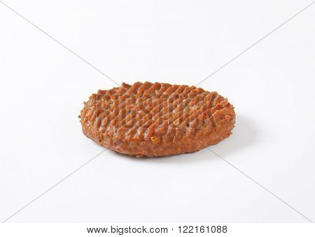 roasted hamburger patty on white background