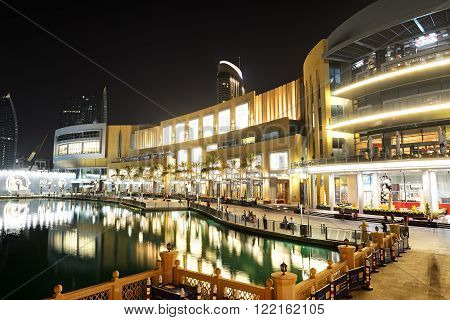DUBAI UAE - SEPTEMBER 9: The Dubai Mall is the world's largest shopping mall. It is located in Burj Khalifa complex and has 1200 shops inside on September 9 2013 in Dubai UAE
