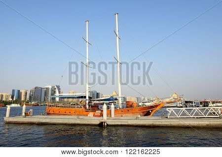 The wooden yacht is in a port of Dubai Creek, United Arab Emirates