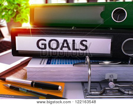 Goals - Black Office Folder on Background of Working Table with Stationery and Laptop. Goals Business Concept on Blurred Background. Goals Toned Image. 3D.