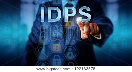 Systems administrator pressing IDPS on a touch interface. Business metaphor and information technology concept for Intrusion Detection and Prevention System designed to detect network-based attacks.