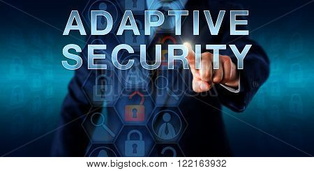 Network supervisor is touching ADAPTIVE SECURITY onscreen. Business metaphor. Information technology and security concept for secure network control protecting enterprises against advanced threats.