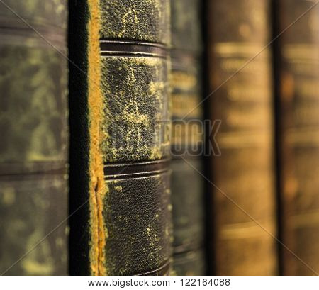 Close up of ancient books on shelf