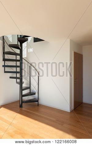 Interior, spiral staircase of a modern loft