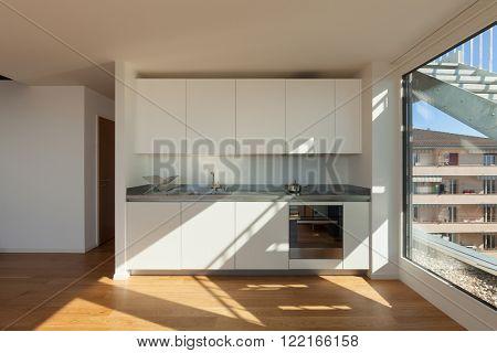 Interior of nice apartment, white domestic kitchen