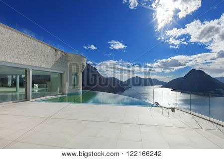 Architecture, modern penthouse with infinity pool, exterior