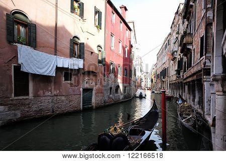 Venetian Canal With Black Gondola