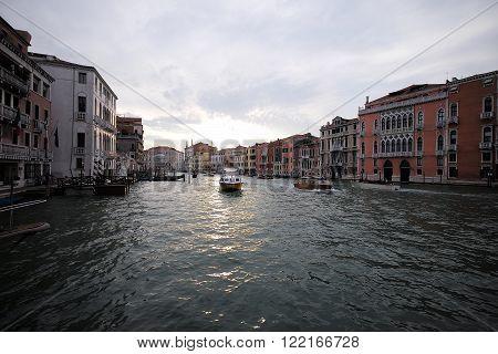 Motorized Waterbus Floats Along Canal