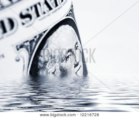 Conceptual image showing US dollars sinking in simulated water