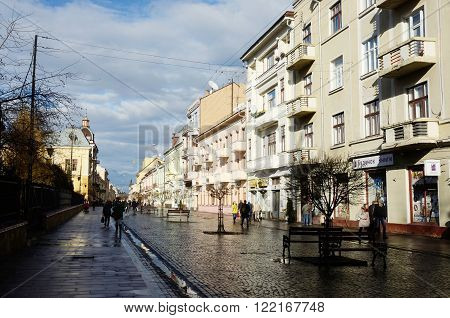 CHERNIVTSI UKRAINE - DECEMBER 1 2015: view of Olga Kobylyanska avenue after rain - the only one pedestrian street in town on December 1 in Chernivtsi, Ukraine.It is historical center of Chernivtsi and popular walking route.Chernovtsy is a city in western