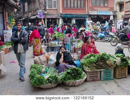 KATHMANDU NEPAL - 4 APRIL 2014: The street vendor sels his fruits and vegetables in Thamel in Kathmandu Nepal. ** Note: Shallow depth of field