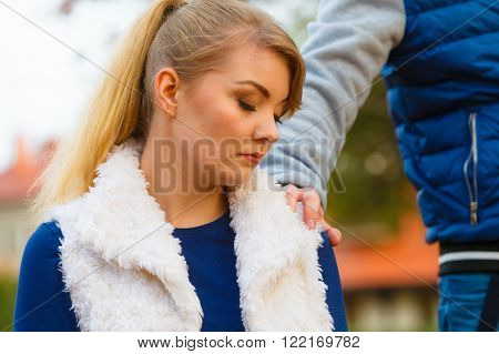 Mental problems stress and fatigue. Seasonal depression and sadness. Seeking help and assistance. Tired young woman sit outside looking for help and guidance. Boyfriend consoling girlfriend