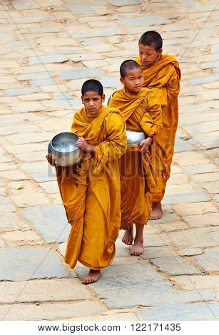 BHAKTAPUR NEPAL - APRIL 5: Little Buddhist monks on the street on April 05 2014 in Bhaktapur Nepal ** Note: Visible grain at 100%, best at smaller sizes