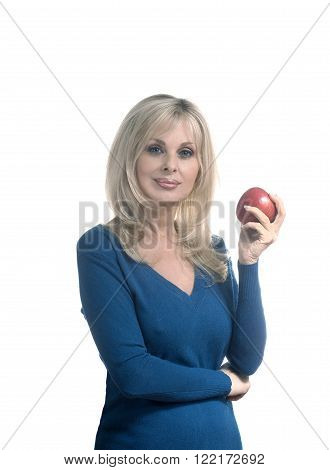 Caucasian woman holding apple against white background.