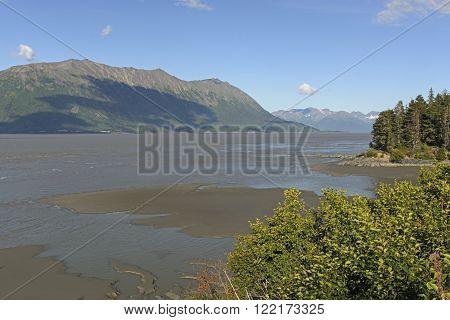 Mud flats at low tide in the Turnagain Arm of the Kenai Peninsula in Alaska