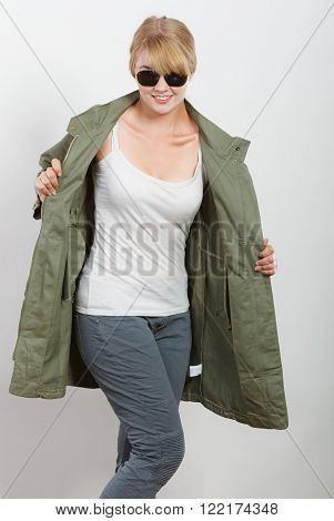 Happy Woman In Dark Green Jacket. Autumn Fashion.